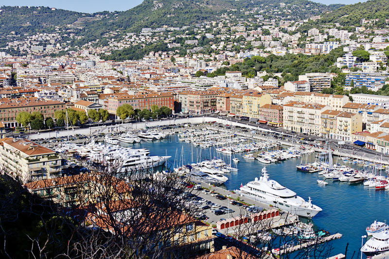 Оld harbor and numerous ships and yachts in Nice. Beautiful view of the old harbor and numerous ships and yachts, made from the Castle Hill in Nice. France stock photo