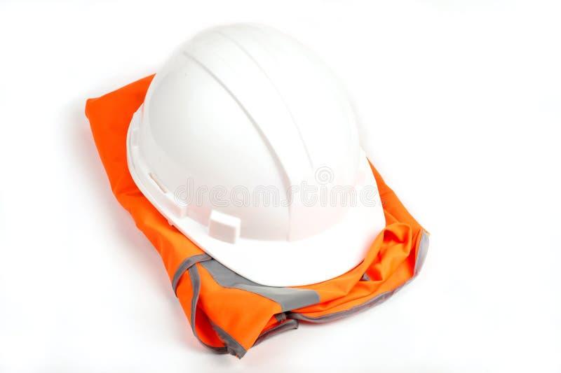 Оrange vest andhard hat. on white. Image of safety equipment, orange vest and hard hat. on white stock photography