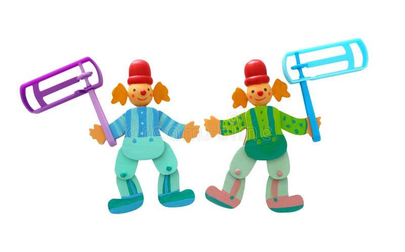 Деревянные красочные клоуны и пластиковый noisemaker стоковые фото