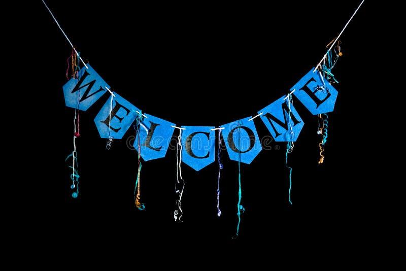 Добро пожаловать знамя партии Голубые письма овсянки говоря гостеприимсво по буквам слова стоковые фото