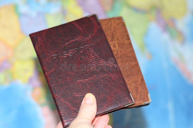 Документ удостоверяющий личность на предпосылке географической карты стоковое фото rf