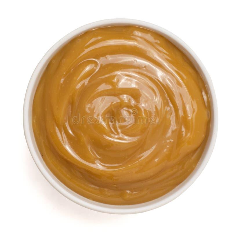 Сладкий соус карамельки в шаре изолированном на белой предпосылке Взгляд сверху стоковые фото