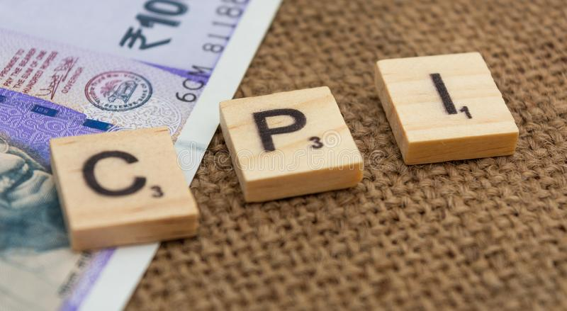 Слово индекса цен на потребительские товары CPI с индийской валютой стоковые изображения
