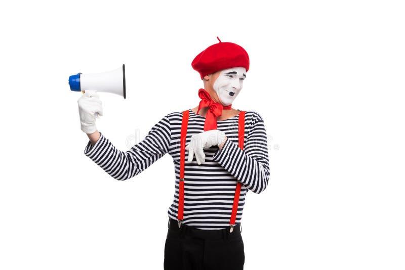смешной громкоговоритель удерживания пантомимы изолировал стоковая фотография