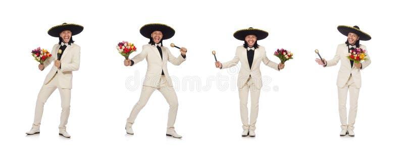 Смешной мексиканец в костюме держа цветки изолированный на белизне стоковая фотография