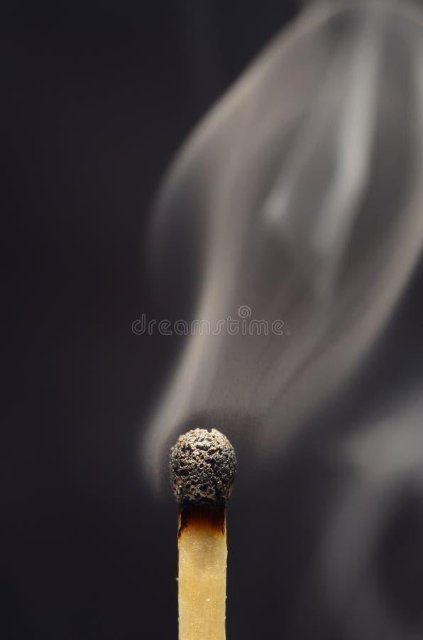 Спичка в огне стоковые фото