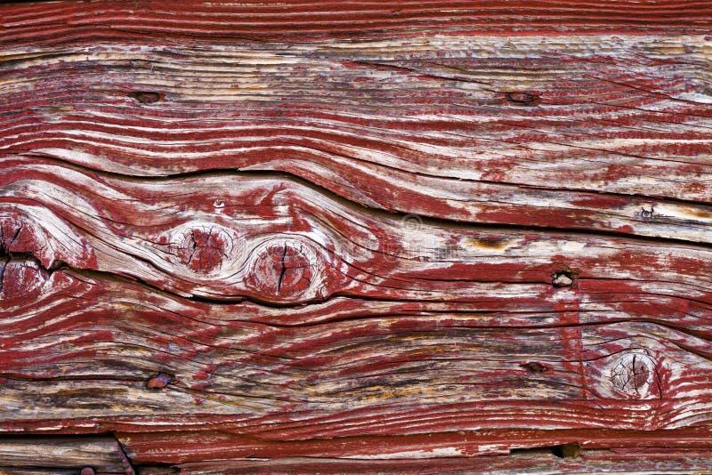 Старая деревянная красная текстура grunge двери стоковая фотография
