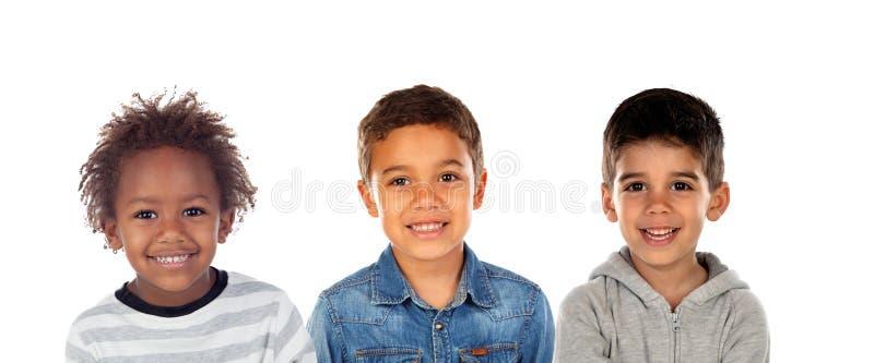 Счастливые дети смотря камеру стоковое фото rf