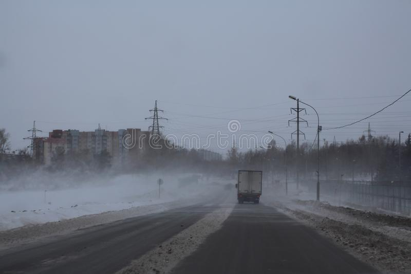 с русс poor visibility on the road in the winter on the track snowstorm sweeps dangerous weather conditions of the trip royalty free stock photo