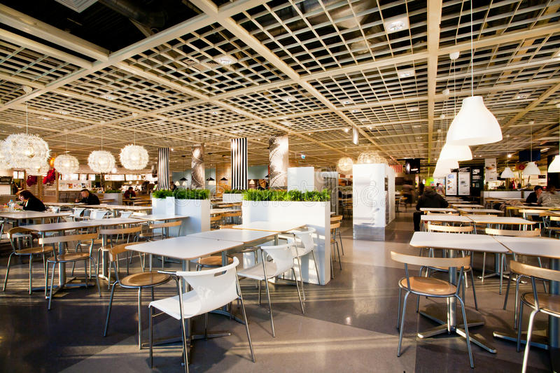 Ð¡afe inside the family shopping mall IKEA. KATOWICE, POLAND: Bright light inside the huge cafe of the popular family shopping mall IKEA. Katowice lies within stock images
