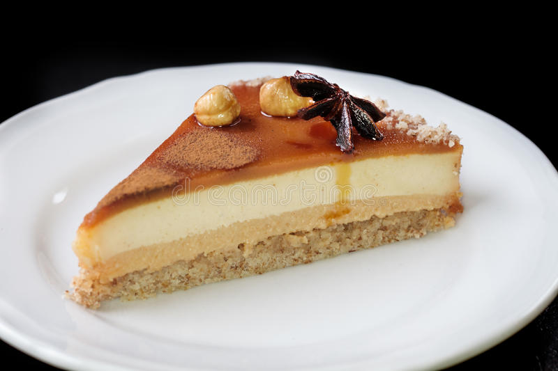 Ð¡ake. Homemade cheesecake with macadamia and caramel sauce topping. You can apply for cake background cake backdrop cake wallpaper cake with text and stock photos