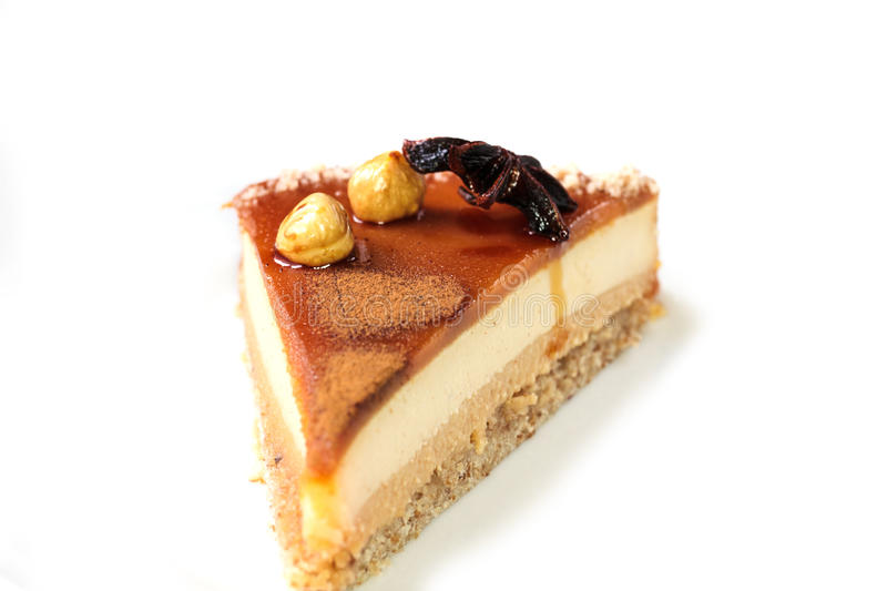 Ð¡ake. Homemade cheesecake with macadamia and caramel sauce topping. You can apply for cake background cake backdrop cake wallpaper cake with text and royalty free stock photos