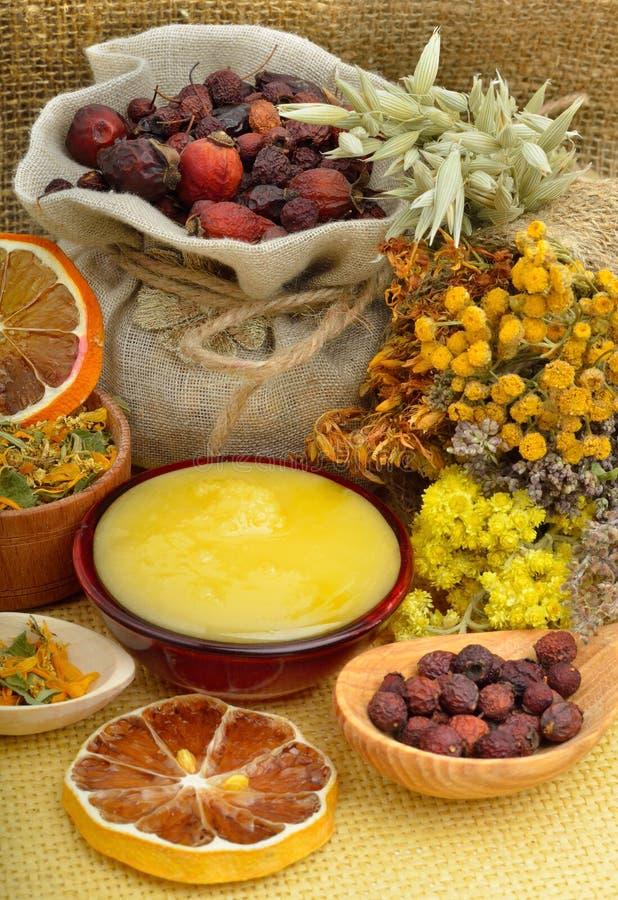Ð¡alendula flower, oats, immortelle flower, tansy herb, honey, w. Ild rose, dried lemon on sacking background stock photo