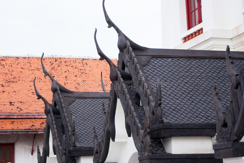 Ð¡arved oriental buildings in Bangkok temple. Thailand royalty free stock images