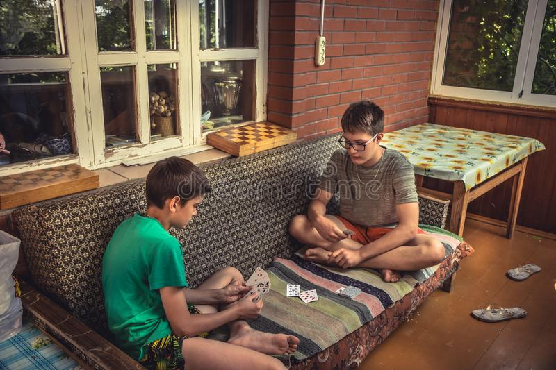 Ð¡hildren during leisure time playing gambling during summer holidays in countryside symbolizing carefree childhood royalty free stock photos