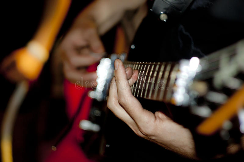 Ð¡hord. Guitarist takes a chord on the guitar stock photography
