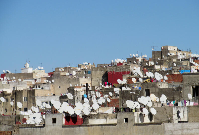 Ð¡ityscape satellite on the roofs. Old small houses in arabic city medina with satellites royalty free stock image