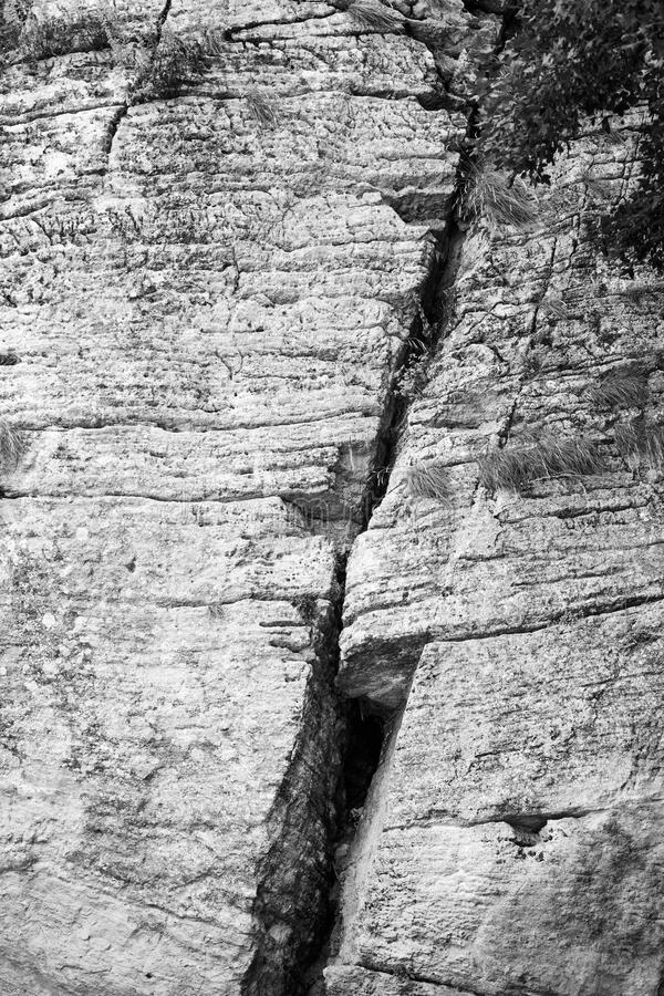 Ð¡left in the rock. Crack in the rock. Cleft in the rock. Abstract texture of stone wall. Background royalty free stock photos
