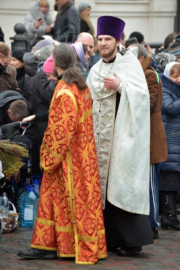 Ð¡lergy. Dnepr river, Dnepropetrovsk City, Ukraine, - January 19, 2015. In the center of Dnepropetrovsk City celebrating Orthodox Baptism. After the prayer in royalty free stock photos