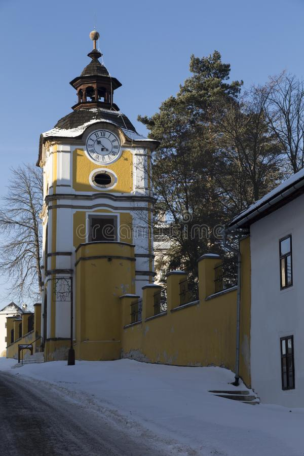 Ð¡lock tower in ancient Spisska Kapitula, Spisske Podhradie, Slovakia. Ð¡lock tower in ancient Spisska Kapitula, known as Slovak Vatican on background blue royalty free stock photos