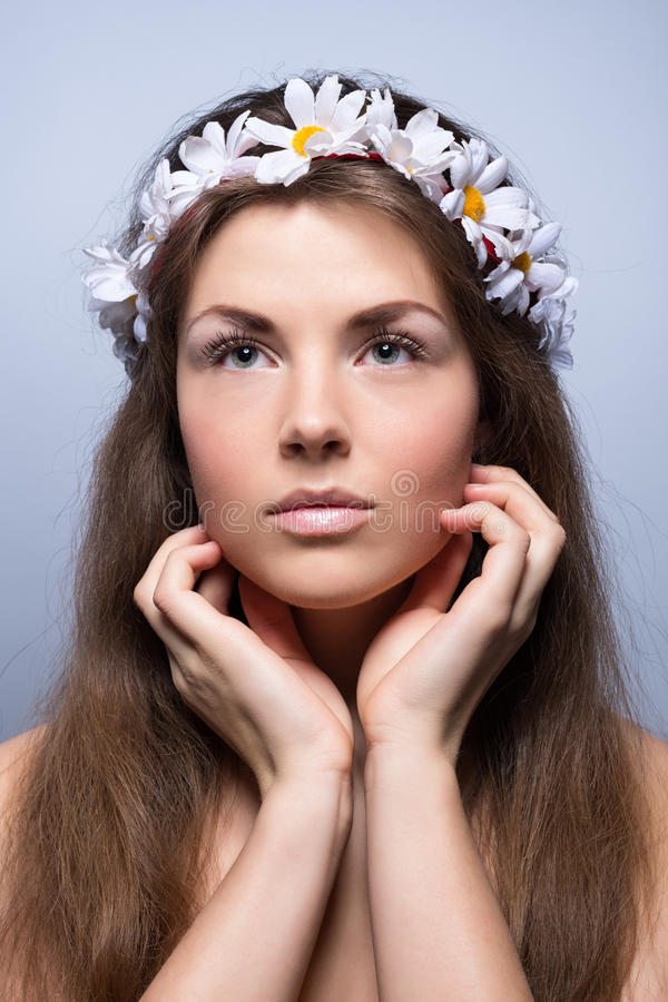 Young Beautiful Woman With Flowers In Her Hair And Bright