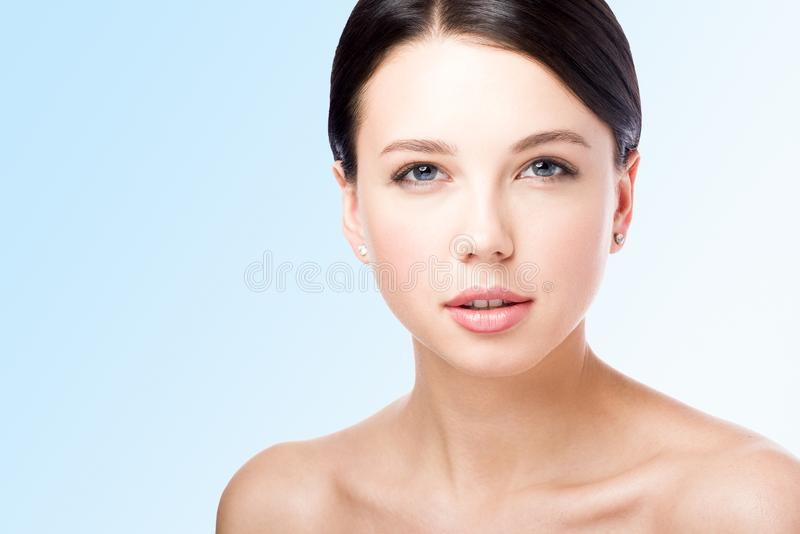 Ð¡loseup beauty portrait. The face of a beautiful young woman. Lips royalty free stock photography