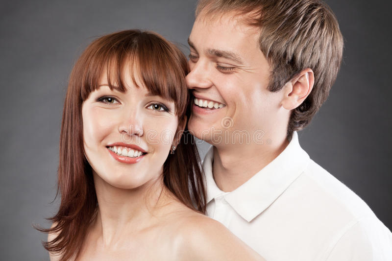 Ð¡loseup portrait of happy young man and woman. stock images