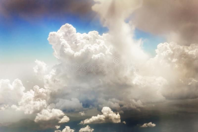 Ð¡louds in sky. Bright clouds in sky illuminated by sun ovet mountains royalty free stock photo