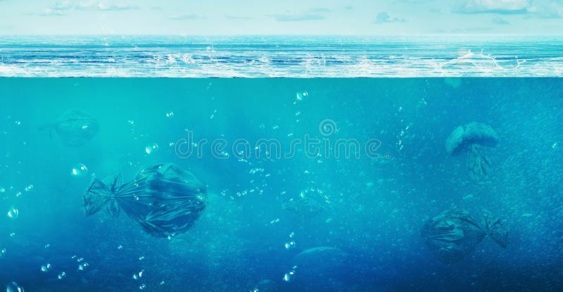 Ð¡oncept of global pollution. In the open ocean floating trash b royalty free stock image