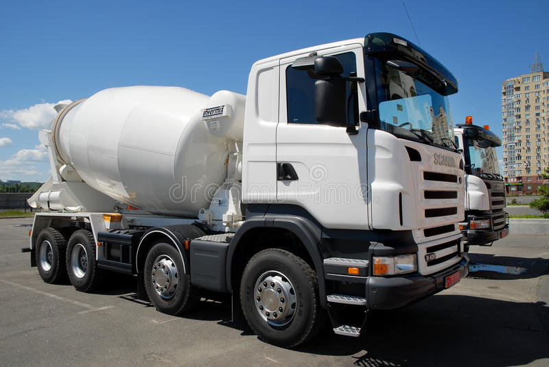 Ð¡oncrete mixers truck. Kiev, Ukraine - May 26, 2009.A pair of white concrete mixers truck Scania stock photos