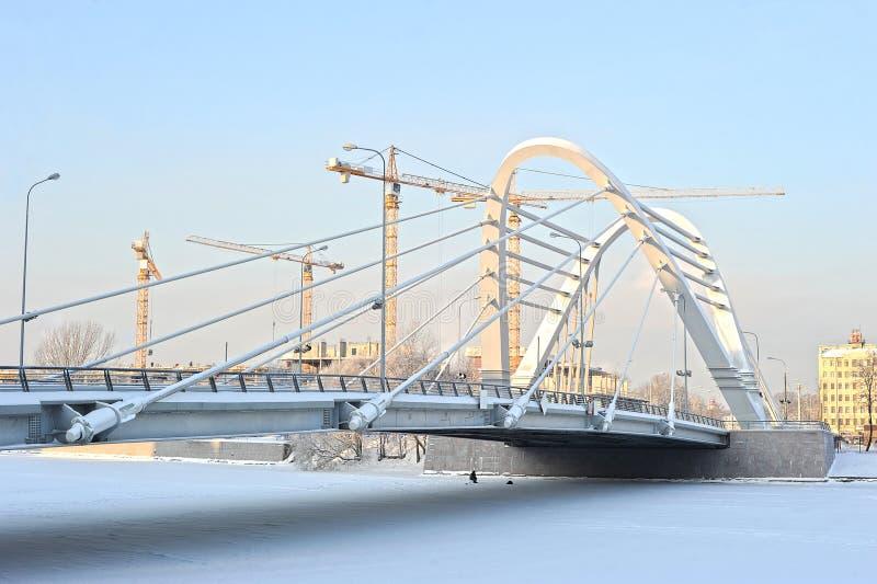 Ð¡onstruction cranes and Lazarevsky bridge royalty free stock photography