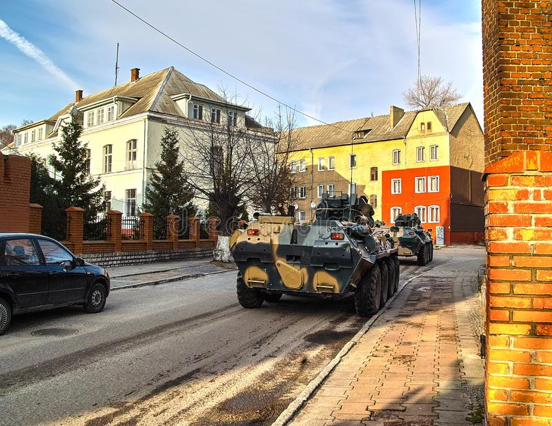 Ð¡onvoy of military equipment. The movement of the convoy of military equipment on public roads in the exercise royalty free stock image