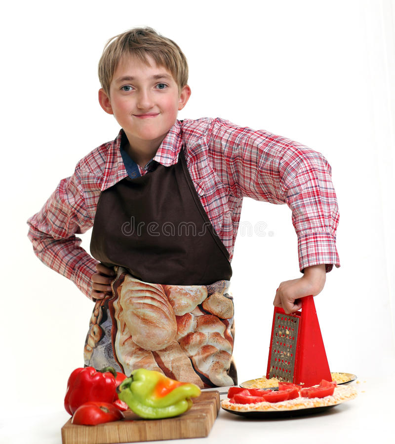 Ð¡ooking boy royalty free stock images