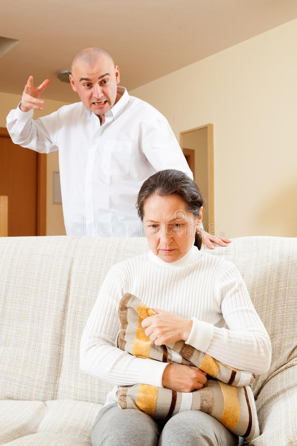 Ð¡ouple having problems. Middle-aged married couple having quarrel at home stock photography