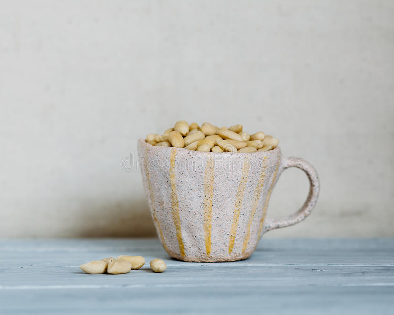 Ð¡up with peanuts royalty free stock photo