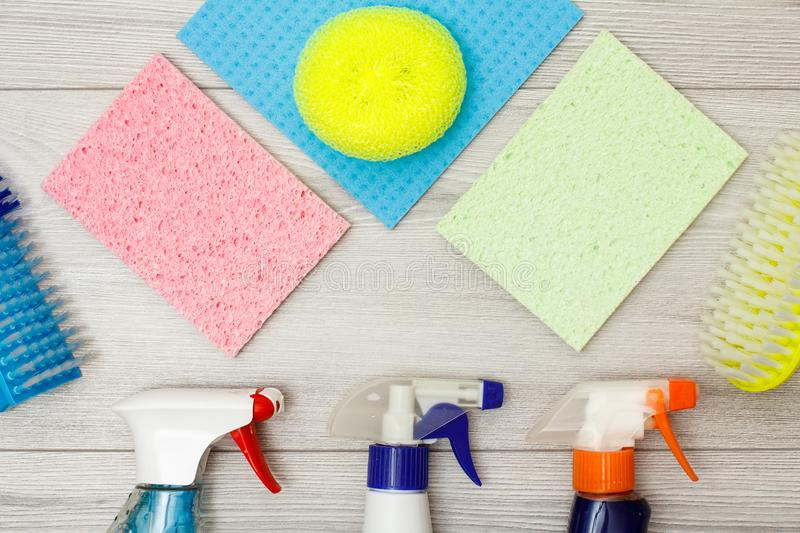 ЯBottles of detergent, color microfiber napkins, synthetic sponge royalty free stock image