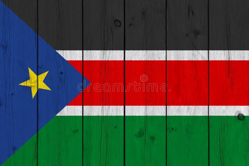 Южный флаг Судана покрашенный на старой деревянной планке стоковое фото