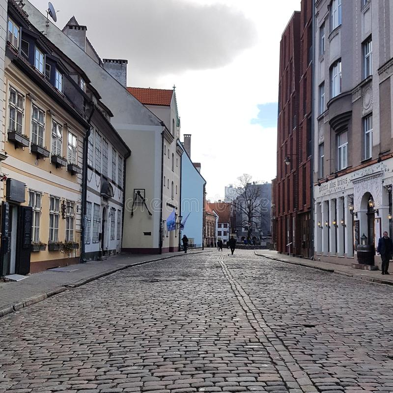On the streets of Riga, Latvia. Улицы старейшей части города на правом берегу реки Даугавы, знамениты своими соборами и другими историческими зданиями. Vecrīga or Old Riga is the historical center of Riga, Latvia, located on the east side of Daugava River. Vecrīga is famous for its old churches and cathedrals, such as Riga Cathedral and St. Peter`s church stock photos