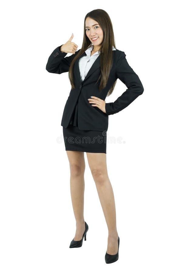 Усмехаясь азиатская молодая бизнес-леди с большим пальцем руки вверх стоковая фотография