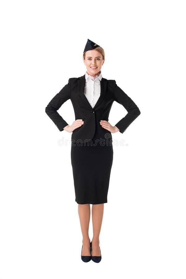 Усмехаясь молодой stewardess в форме стоковое изображение
