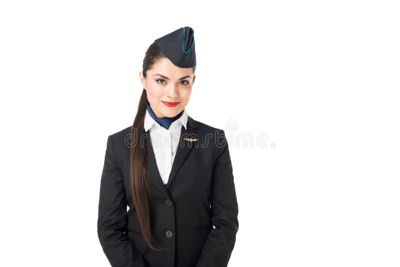 Усмехаясь молодой stewardess смотря камеру стоковая фотография