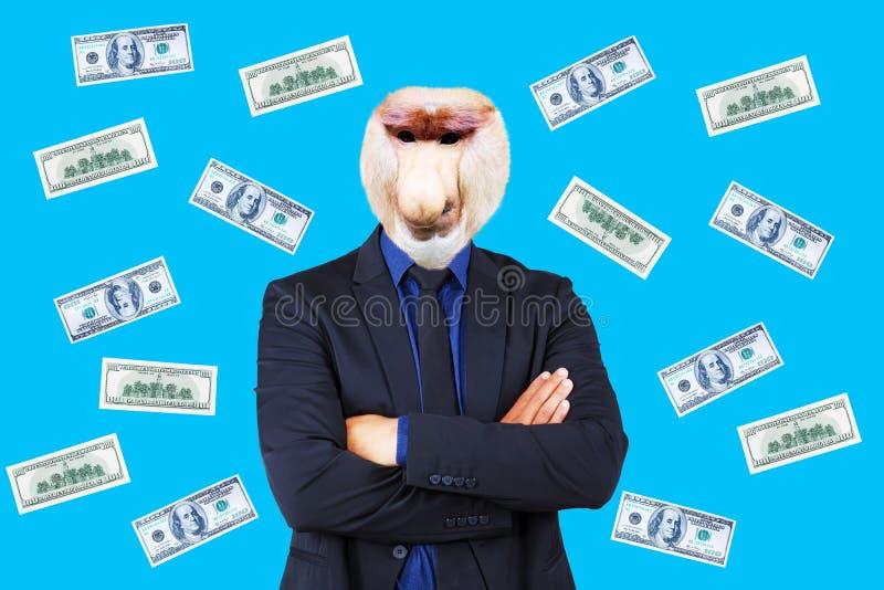 Успешный бизнесмен с головой обезьяны хоботка стоковые фотографии rf