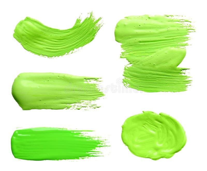 Установите с абстрактными brushstrokes зеленой краски на белой предпосылке иллюстрация штока