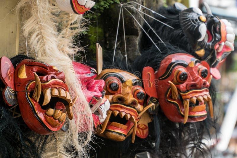 Традиционные деревянные балийские маски стоковая фотография