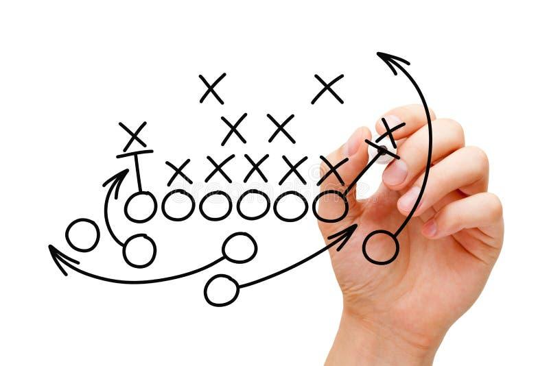 Тренер рисуя стратегию плана американского футбола стоковая фотография rf