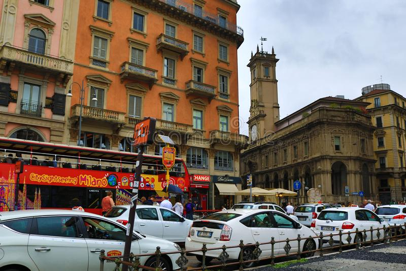 Тaxi rank historic center Milan city Italy. Taxi rank with many white taxi cars at Piazza del Duomo in the heart of the city on a rainy summer day,Milan Italy stock photos