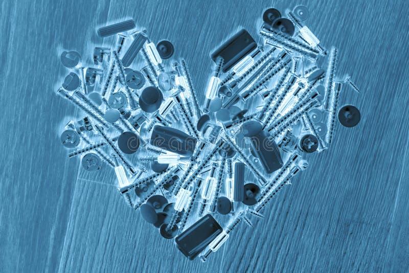 Тонизированное изображение сердца болтов, ногтей, абстрактного влияния стоковое фото