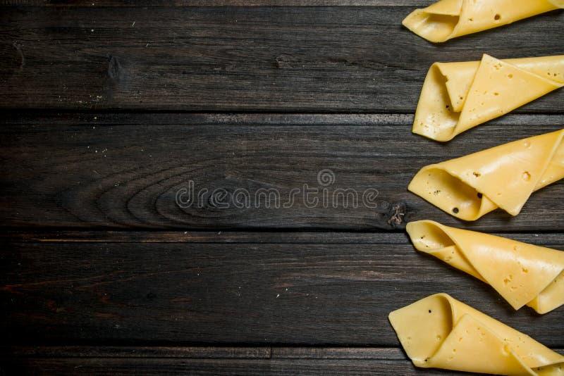 Тонкие ломтики сыра стоковые изображения rf