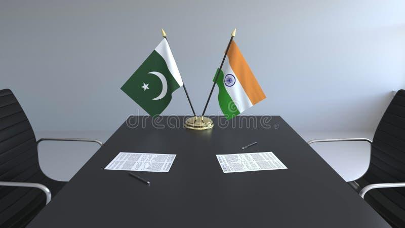 Флаги Пакистана и Индии и бумаги на таблице Переговоры и подписание международного соглашения Схематическое 3D иллюстрация штока