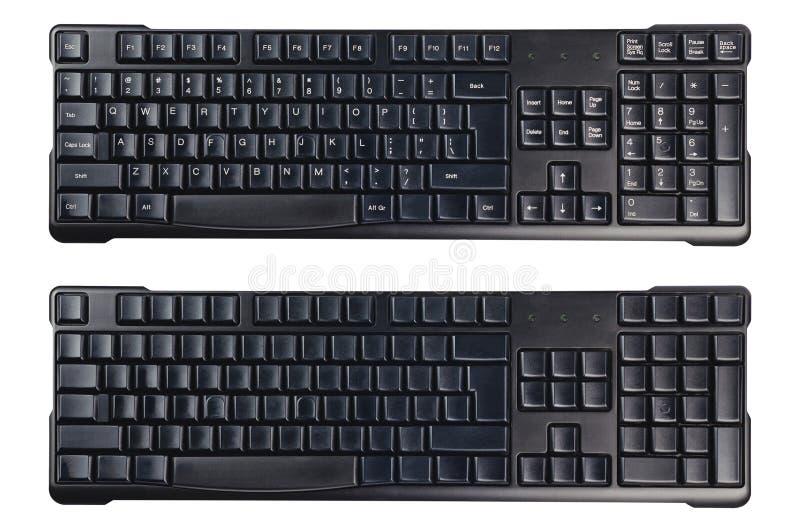 Черные пластиковые беспроводные клавиатуры компьютера с символами и без изолированный на белой предпосылке стоковые изображения